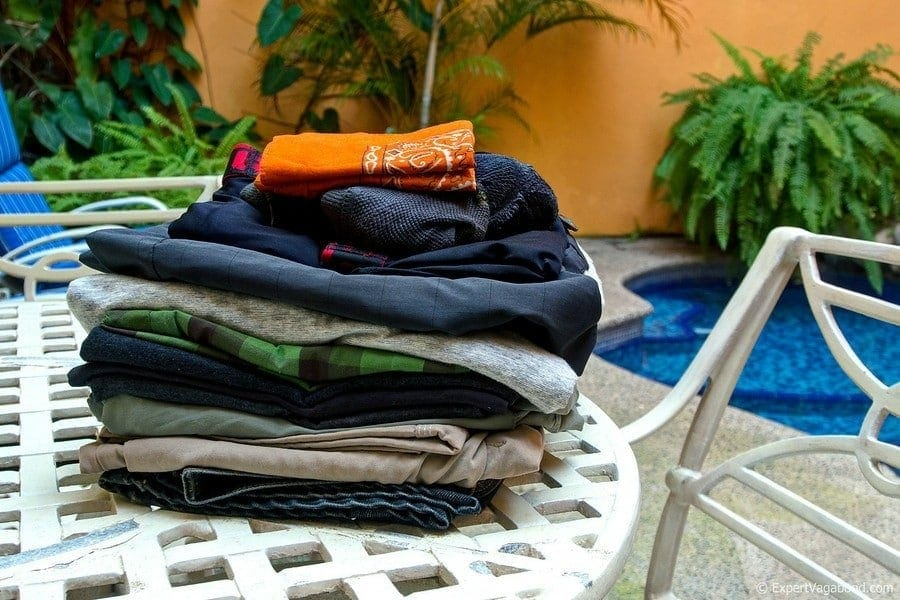 pile of clothes by pool