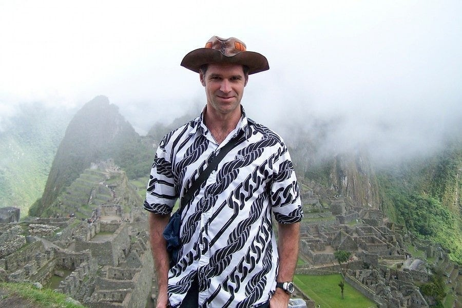 man at machu picchu with hat