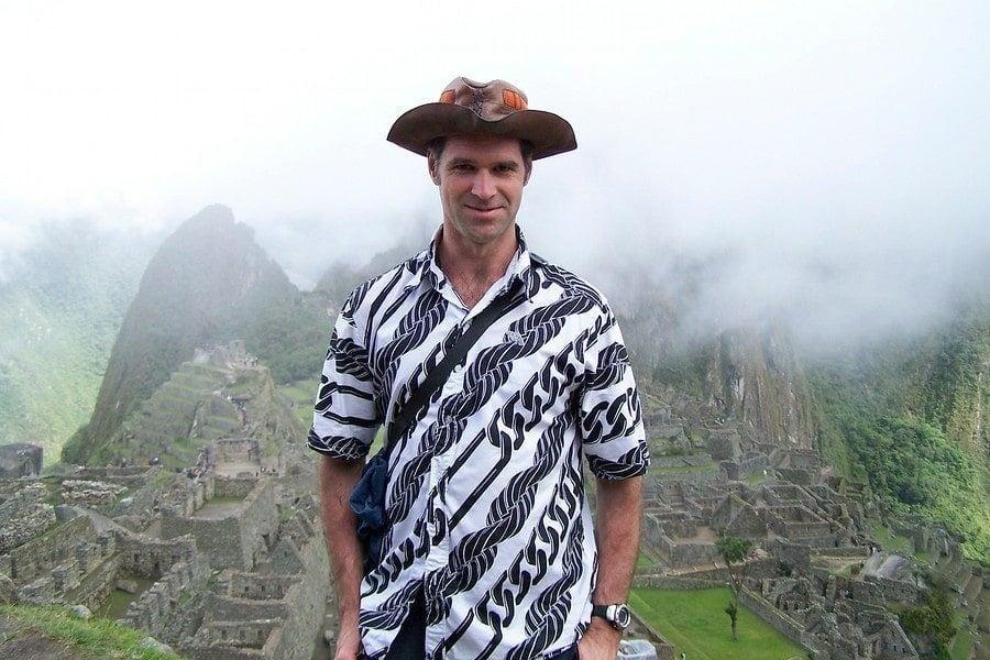 man at machu picchu with hat
