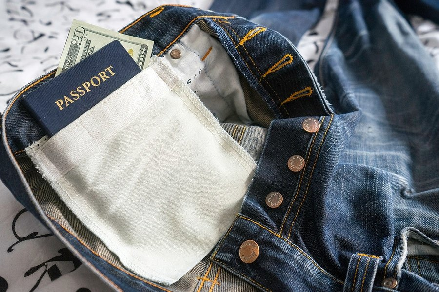 passport and money in jean pocket