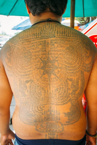 Man with Full Back Tattoo