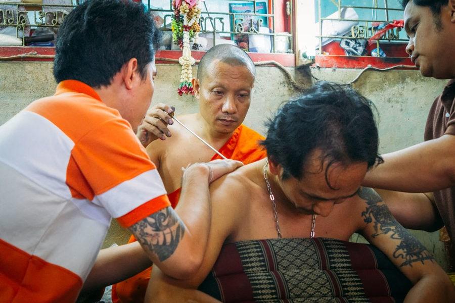 Thai Monk performing Tattoo